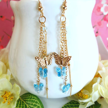 Cinderella blue Swarovski butterfly gold tassle earrings