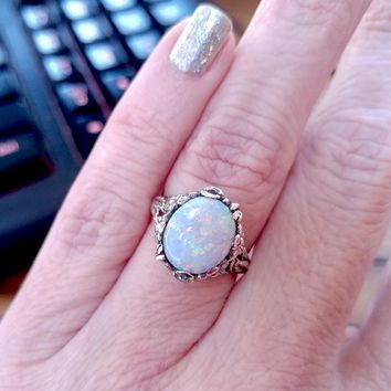 12x10mm Oval Cabochon Opal in a 14k White Gold Floral Setting
