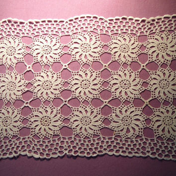 Hand crocheted tablecloth with floral pattern