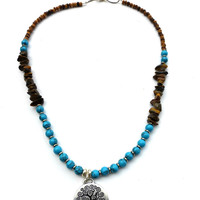Blue turquoise stone, wood, tigers eye stone with silver necklace.