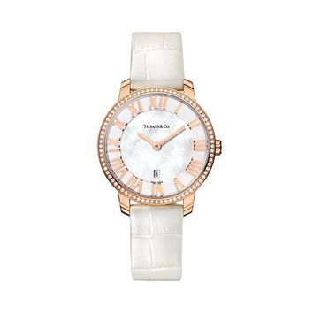 Tiffany & Co. -  Atlas® dome watch in 18k rose gold with diamonds, quartz movement.