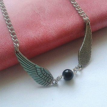 Harry potter necklaces, wing necklace, gold stolen necklace, silver wings, black pearls. Magic. , the gift of friendship