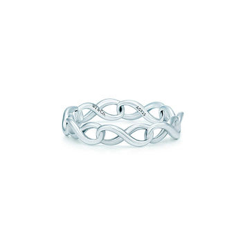 Tiffany & Co. - Tiffany Infinity narrow band ring in sterling silver.