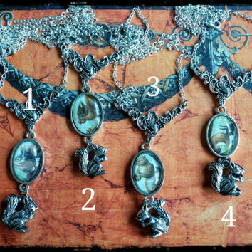 Handmade cabochon silver squirrel necklaces, four different