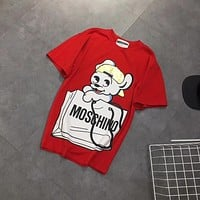 """Moschino"" Women Cute Bronzing Cartoon Dog Letter Print Short Sleeve Cotton T-shirt Top Tee"