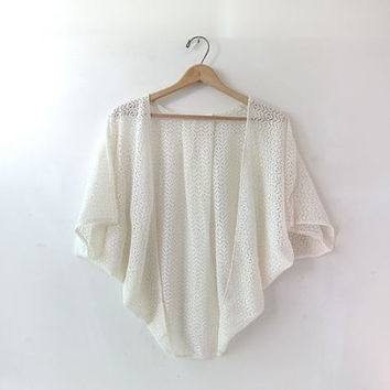 70s crocheted shawl. cream white knit cape. cut out swimsuit coverup.