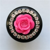 Add sparkle to any space with these beautiful black wooden drawer knobs with crystals and hot pink flower! Furniture knobs are a simple way to personalize your dressers or cabinets. These knobs are lovingly hand-crafted, and can be personalized to your de