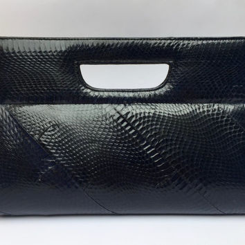 Vintage 1970s navy snakeskin clutch with diagonal panelling, cut out handle and suede lining