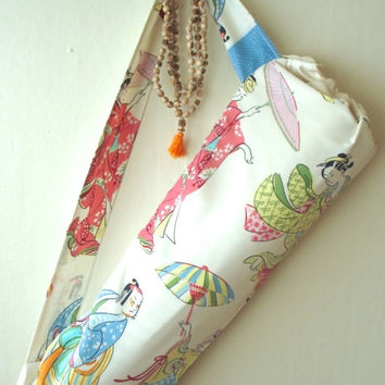 Lightweight upcycled yoga mat carrier. Upcycled Japanese print fabric, satin lined with drawstring. Fits standard sized mat.