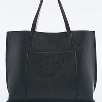 Reversible Vegan Leather Pocket Tote Bag in Black and Ivory - Urban Outfitters