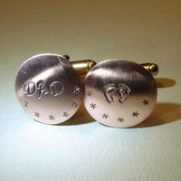 Copper cuff links for a new dad with baby feet