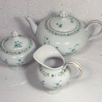 Limoges porcelain teapot set. French teapot set. Teapot set. French dining. Teatime. White floral porcelain. Limoges sugar pot. Limoges jug