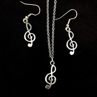 Silver treble clef music symbol necklace and earring set