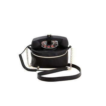 Be the talk of the town! Betsey bag is uniquely equipped with a functioning phone handle that plugs into your cell, with fully lined interior making for a purse that's tech-savvy and totally chic.