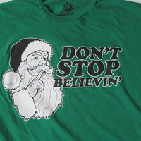 13-1207 Don't Stop Believing T Shirt / Christmas T Shirt / Santa Claus T Shirt / Green T Shirt / Green TShirt