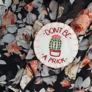 Don't Be A Prick hand embroidered patch accessory with pin on back