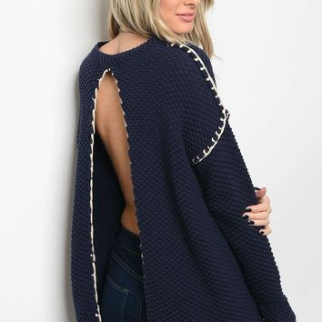 Ladies fashion long sleeve cream chunky knit sweater top that features a open back and rounded neckline