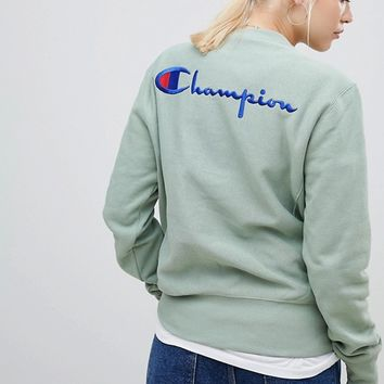 Champion Relaxed Sweatshirt With Small Script Logo at asos.com