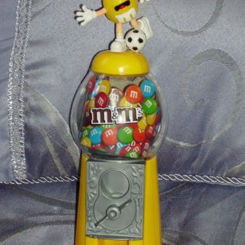 Yellow M&M Candy Dispenser - Soccer Player with a Soccer Ball