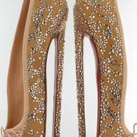 Christian Louboutin official web site. Luxury french shoe and bag designer.