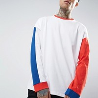 ASOS Oversized Long Sleeve T-Shirt With Mismatch Sleeve And Panelling In Heavyweight at asos.com