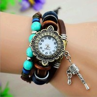 Vintage Style Leather Belt Flower Dial Watch with Prayer Wheel by jimmywei on Zibbet