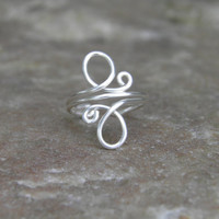 Toe ring... whirls ...sterling silver wire wrapped toe ring.