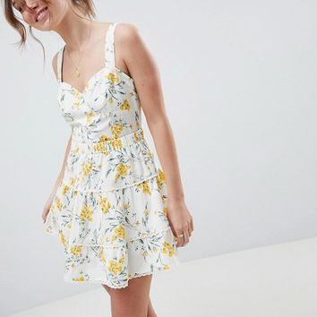 ASOS DESIGN tiered mini skirt co-ord in floral print at asos.com