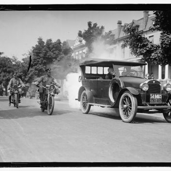 c1923 Police on Motorcycles trailing smoking Automobile -Antique-Vintage B&W Reproduction Photograph: Gicclee Print. Frame it!