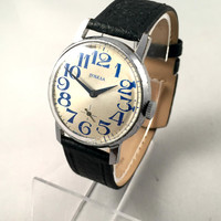 "Vintage men's ""VICTORY"" (Pobeda ) wristwatch.Round face Soviet watch with silver dial, comes with brand new leather band."
