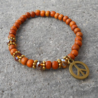 Peace, wood, crystal and peace charm mala bracelet