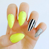 Stiletto nails neon yellow striped holographic claw nails