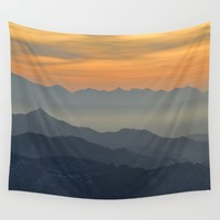 Sunset at the mountains Wall Tapestry by Guido Montañés