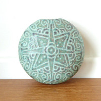 Round green pottery wall vase
