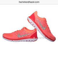 Womens 2015 Nike Flex in fabulaous coral with hand placed Swarovski crystal swoosh