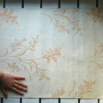Retro vintage Soviet era wallpaper from the 1970s with creamy wheat / grass patterns
