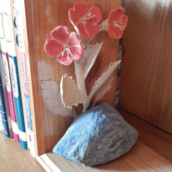 Wood Carving Bookend with Crimson Flowers leaning on a Lake Superior shore rock--use as a traditional bookend or as a shelf art accessory