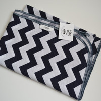 Navy and white blanket with navy trim.  Chevron, zig-zag print.  Blanket size: Size 31 by 40 inches.  (Made by lippybrand)