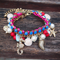 Fun Beach Bracelet with Natural Seashell and Ocean Theme Charms Dark Blue