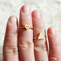 tiny  gold skull  ring above knuckle ring wedding  ring