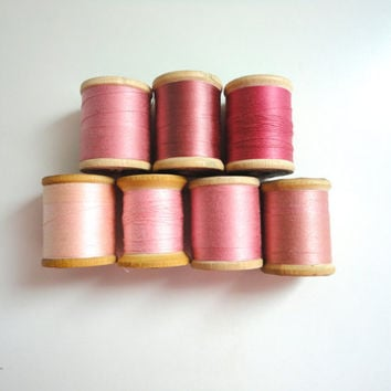 Vintage sewing thread lot of 7 wooden spools in hues of pink
