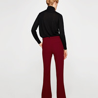 FLARED FLOWING TROUSERS