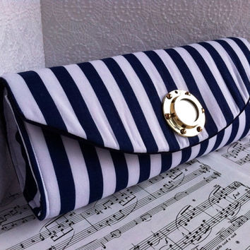 Blue and white striped nautical clutch bag with brass porthole