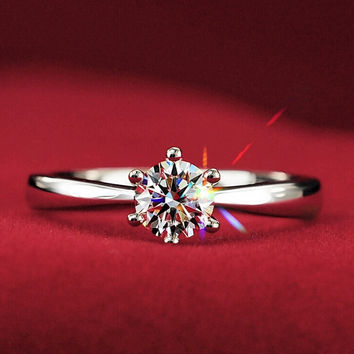 Simple CZ Solitaire Engagement Ring