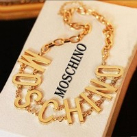 MOSCHINO metal letters gold thin waist belt F