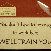 You don't have to be crazy to work here. WE'LL TRAIN YOU. Mountain Meadows Pottery ceramic desk plaques and wall art signs with humorous sayings and quotes about working, crazy fun work places, great co-workers, and bosses. Made by Mountain Meadows Pottery