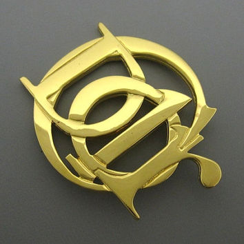 Vintage Christian Dior gold tone logo brooch. Great vintage gift. Can be a scarf pin.