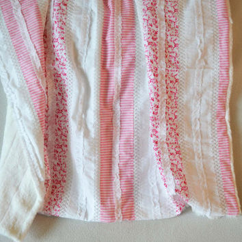 Baby girl quilt with plush backing.  White and pinks with ruffles and crochet detail. Size- 36X31 inches.  Made by lippybrand.