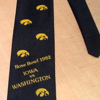Vintage collectible souvenir neck tie commemorating the 1982 Rose Bowl Game between the Iowa Hawkeyes and the Washington Huskies. Hawks tie