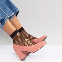ASOS DESIGN oversized fishnet ankle socks at asos.com